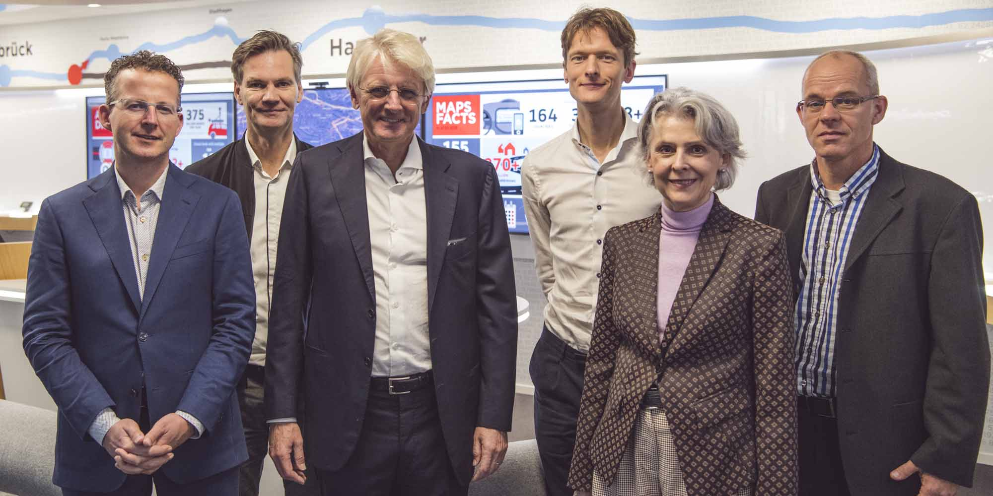 Professors Cees Snoek and Theo Gevers, CEO of TomTom Harrold Goddijn, Willem Strijbosch of TomTom, rector magnificus Karen Maex and director of the Informatics Institute Marcel Worring.
